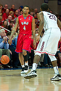 DALLAS, TX - JANUARY 4: Keith Frazier #4 of the SMU Mustangs brings the ball up court against the Connecticut Huskies on January 4, 2014 at Moody Coliseum in Dallas, Texas.  (Photo by Cooper Neill) *** Local Caption *** Keith Frazier