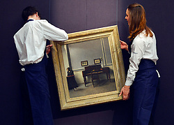 © Licensed to London News Pictures. 17/05/2013. London, UK Staff hang VILHELM HAMMERSHØI. DANISH.1864 - 1916. IDA IN AN INTERIOR WITH PIANO.Estimate: 1,000,000 - 1,500,000 GBP .A photo call for a preview of 19th Century European Paintings held at Sotheby's London today 17th May 2013. The paintings will be offered to auction on 23 May 2013. Photo credit : Stephen Simpson/LNP