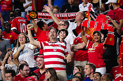 July 31, 2018 - Miami Gardens, Florida, USA - Manchester United F.C. fans celebrate during an International Champions Cup match between Real Madrid C.F. and Manchester United F.C. at the Hard Rock Stadium in Miami Gardens, Florida. Manchester United F.C. won the game 2-1. (Credit Image: © Mario Houben via ZUMA Wire)