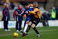 Photo: Richard Lane.<br />Wolverhampton Wanderers v Crewe Alexander. Coca Cola Championship. 11/02/2006.<br />Wolves' Kenny Miller (R) challenges Crewe's Jon Otsemobor.