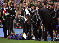 Photo: Paul Thomas.<br /> Chelsea v Liverpool. UEFA Champions League. Semi Final, 1st Leg. 25/04/2007.<br /> <br /> Jose Mourinho (3rd R), manager of Chelsea, gives instructions to Didier Drogba (Ground) as he lays injured.