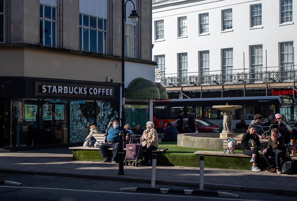25th February 2021. Shoppers enjoying the sun during the third national lockdown in Cheltenham High Street.