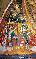 Twelfth century Romanesque frescoes of the Apse of Estaon depicting a Byzantine style angels with Archangel Gabriel,  from the church of Sant Eulalia d'Estaon, Vall de Cardos, Catalonia, Spain. National Art Museum of Catalonia, Barcelona. MNAC 15969 .<br /> <br /> If you prefer you can also buy from our ALAMY PHOTO LIBRARY  Collection visit : https://www.alamy.com/portfolio/paul-williams-funkystock/romanesque-art-antiquities.html<br /> Type -     MNAC     - into the LOWER SEARCH WITHIN GALLERY box. Refine search by adding background colour, place, subject etc<br /> <br /> Visit our ROMANESQUE ART PHOTO COLLECTION for more   photos  to download or buy as prints https://funkystock.photoshelter.com/gallery-collection/Medieval-Romanesque-Art-Antiquities-Historic-Sites-Pictures-Images-of/C0000uYGQT94tY_Y