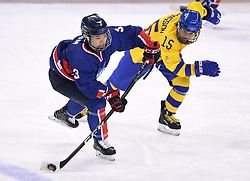PYEONGCHANG, Feb. 12, 2018  Eom Suyeon (L), defence of the unified team of the Democratic People's Republic of Korea (DPRK) and South Korea vies for the puck against Sweden's forward Lisa Johansson during their preliminary match of women's ice hockey at the Pyeongchang 2018 Winter Olympic Games at the Kwandong Hockey Centre in Gangneung, South Korea, on Feb. 12, 2018. The unified team of the Democratic People's Republic of Korea (DPRK) and South Korea lost 0:8. (Credit Image: © Ju Huanzong/Xinhua via ZUMA Wire)