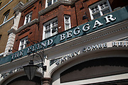 Exterior of the famous Blind Beggar pub in Whitechapel, London, United Kingdom. Infamous as the place where on 9 March, 1966, Ronnie Kray shot and murdered George Cornell, an associate of a rival gang, the Richardsons, as he was sitting at the bar. The murder took place in the then saloon bar. Whitechapel High Street in East London.