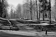 """Verdun WW1 Battlefield site, Verdun-sur-Meuse, France. March 2014<br /> Seenhere:<br /> During the war, the village of Douaumont on the Verdun Battlefield was completely destroyed ( one of nine 'Villages Detruits' in the area ) and the land was made uninhabitable to such an extent that a decision was made not to rebuild it. The area around the municipality was contaminated by corpses, explosives and poisonous gas, so no farmers could take up their work. The site of the commune is maintained as a testimony to war and is officially designated as a """"village that died for France."""" It is managed by a municipal council of three members appointed by the prefect of the Meuse department. The white markers indicate the names and professions of the previous inhabitants.<br /> <br /> The Battle of Verdun lasted 9 months, 3 weeks and 6 days between 21 February and 20 december 1916. It was the longest and one of the most costly battles in human history;  recent estimates increase the number of casualties to 976,000.<br /> <br /> Caption information below from wikipedia:<br /> The Battle of Verdun (Bataille de Verdun0, was fought from 21 February – 18 December 1916 during the First World War on the Western Front between the German and French armies, on hills north of Verdun-sur-Meuse in north-eastern France. The German Fifth Army attacked the defences of the Région Fortifiée de Verdun (RFV) and the Second Army on the right bank of the Meuse, intending rapidly to capture the Côtes de Meuse (Meuse Heights) from which Verdun could be overlooked and bombarded with observed artillery-fire. The German strategy intended to provoke the French into counter-attacks and counter-offensives to drive the Germans off the heights, which would be relatively easy to repel with massed artillery-fire from the large number of medium, heavy and super-heavy guns, supplied with large amounts of ammunition on excellent pre-war railways, which ran within 24 kilometres (15 mi) of the front-line.<br /> <br /"""