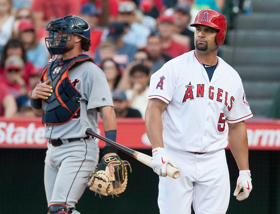The Angels' Albert Pujols heads to the dugout after striking out swinging while pinch hitting in the eighth inning during the Angels' 3-0 loss to the Detroit Tigers Wednesday at Angel Stadium.<br /> <br /> ///ADDITIONAL INFO:   <br /> <br /> angels.0602.kjs  ---  Photo by KEVIN SULLIVAN / Orange County Register  -- 6/1/16<br /> <br /> The Los Angeles Angels take on the Detroit Tigers Wednesay at Angel Stadium.