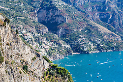 Positano, Italy, September 16 2017. The town of Positano nestles against the steep mountains beside the Mediterranean sea in Italy. © Paul Davey