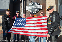 (Left to right) Steve Dutton, Wiley Cress, Jim Entenman, Dick Turnwall, Lonnie Entenman and Randy Ward with the Flag at the Harley-Davidson rally point for the kickoff of the USS South Dakota submarine flag relay across South Dakota. Sturgis, SD. USA. Saturday October 7, 2017. Photography ©2017 Michael Lichter.