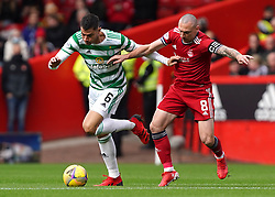 Celtic's Nir Bitton (left) and Aberdeen's Scott Brown battle for the ball during the cinch Premiership match at Pittodrie Stadium, Aberdeen. Picture date: Sunday October 3, 2021.