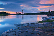 Clouds reflected in Middle Lake at sunrise<br />