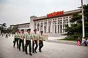 Exterior of The National Museum of China as soldeirs from the People's Liberation Army march past. Flanking the eastern side of Tiananmen Square in Beijing, China. The mission of the museum is to educate about the arts and history of China. It is directed by the Ministry of Culture of the People's Republic of China. The museum was established in 2003 by the merging of the two separate museums that had occupied the same building since 1959. The building was completed in 1959 as one of the Ten Great Buildings celebrating the ten-year anniversary of the founding of the People's Republic of China. After four years of renovation, the museum reopened on March 2011 with 28 new exhibition halls, more than triple the previous exhibition space, and state of the art exhibition and storage facilities. It has a total floor space of nearly 200,000 square meters to display. The renovations were designed by the German firm Gerkan, Marg and Partners.