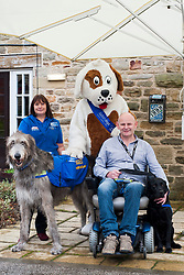 Support Dog trainer Shirley Lumley and Tich the fundraising Irish Wolf Hound with Murdoch the Charity Mascot, John Newcombe and his dog Blue who graduated at the Support Dogs 8th Annual Graduation Awards Ceremony held at Tankersley Manor on Sunday<br /> <br /> 24 November 2013<br /> Image © Paul David Drabble<br /> www.pauldaviddrabble.co.uk