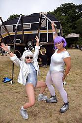 Latitude Festival, Henham Park, Suffolk, UK July 2019. Stallholders in fancy dress