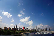 """SHOT 9/7/2007 - The Chicago, Ill. skyline as seen from a vantage point near the Shedd Aquarium. Chicago is the largest city in the state of Illinois, the largest in the Midwest and, with a population of nearly 3 million people, is the third largest in the United States. Chicago is a city rich in history and also renowned for its architecture. Chicago attracts about 33 million visitors annually from around the world and nation. Upscale shopping along the Magnificent Mile, thousands of restaurants, as well as Chicago's eminent architecture, continue to draw tourists every year. Includes images from the Shedd Aquarium, the Magnificent Mile and Millenium Park (Including Cloud Gate aka """"The Bean"""" and Crown Fountain)..(Photo by Marc Piscotty © 2007)"""