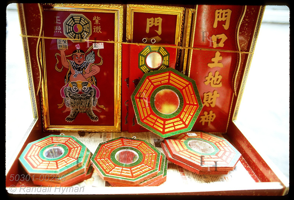 Octagonal mirrors bearing I Ching's 8 trigrams are used in Feng Shui to deflect bad energy; Kwln Hong Kong