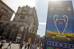 May 18, 2018 - Kiev, Ukraine - Ukrainians walk near a large the logo for the 2018 UEFA Champions League Final in central Kiev, Ukraine, 18 May, 2018. The football UEFA Champions League final match between Real Madrid and Liverpool FC next May 26 at the NSC Olimpiyskiy Stadium. (Credit Image: © Str/NurPhoto via ZUMA Press)