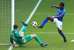 Italy U17's Emmanuel Gyabuaa sees his shot saved by Netherlands U17's Joey Koorevaar