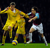 Photo: Alan Crowhurst.<br />West Ham v Liverpool. The Barclays Premiership. 30/01/07. Liverpool's Peter Crouch (L) with Yossi Benayoun.