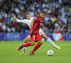 Real Madrid's Gareth Bale battles for the ball with Sevilla's Daniel Carrico - Photo mandatory by-line: Joe Meredith/JMP - Mobile: 07966 386802 12/08/2014 - SPORT - FOOTBALL - Cardiff - Cardiff City Stadium - Real Madrid v Sevilla - UEFA Super Cup