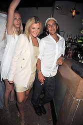 OLIVIA PERRY and  RORY SHEARER at the launch party of the new Embargo 59 nightclub at 533 Kings Road, London on 25th June 2009.