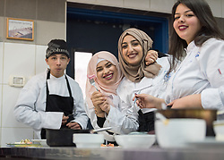 25 February 2020, Jerusalem: Students enjoy the food they have prepared during catering class at the vocational training centre in Beit Hanina. The Lutheran World Federation's vocational training centre in Beit Hanina offers vocational training for Palestinian youth across a range of different professions, providing them with the tools needed to improve their chances of finding work.
