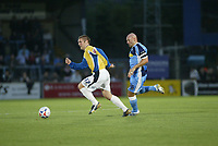 Photo: Marc Atkins.<br /> Wycombe Wanderers v Mansfield Town. Coca Cola League 2. 01/09/2006. Jake Buxton (L) of Mansfield is chased by Tommy Mooney of Wycombe.