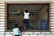 A younger student climbs the bars on the classroom window as class is being conducted inside at the Escuela Republica del Mexico.  Children ask questions in english class at a school in Guaimaca, Honduras.  Over 94% of Honduran children are enrolled in school, yet only 40% actually complete their schooling.  Hounduras is considered the third poorest country in the Western Hemisphere (Haiti, Nicaragua). With over 50% of the population living below the poverty line and 28% unemployed, Hondurans frequently turn to illegal immigration as a solution to their desperate situation. The Department of Homeland Security has noted an 95% increase in illegal immigrants coming from Honduras between 2000 and 2009, the largest increase of any country.