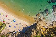 Beachgoers at Crescent Bay Beach
