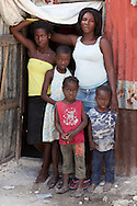 Michel Donason and her four children in front of their home in Wharf Jeremie a slum,  one of the poorest areas of Port-au-Prince that has a high conentriaton of cases of cholera. The Cholera epedemic in Haiti is hard to stop due to the lack of snaititaion in coutnry wide.