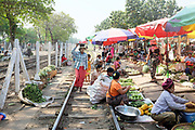 Women selling local produce at Danyingone Station on 19th March 2016 in Yangon, Myanmar. At Danyingone Station, one of the Circular Railways 39 stations, the market spills out onto the tracks.