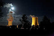 full moon over atomic power plant cooling towers in France Golftech