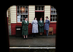 © Licensed to London News Pictures. <br /> 15/10/2016. <br /> Goathland, UK.  <br /> <br /> Women dressed in period clothing stand outside a cafe at Goathland station during the North Yorkshire Moors Railway Wartime Weekend event. <br /> The annual event brings together re-enactors and enthusiasts along the length of the NYMR heritage steam railway line to recreate the feel of the war years of the 1940's. <br /> <br /> Photo credit: Ian Forsyth/LNP