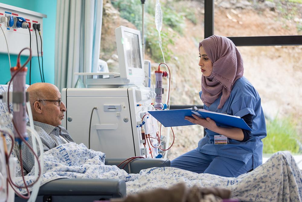 24 February 2020, Jerusalem: Nurse Hiba Almu'ti tends to Shehadi Dar-Awad, as he receives Dialysis treatment at the Augusta Victoria Hospital in Jerusalem.