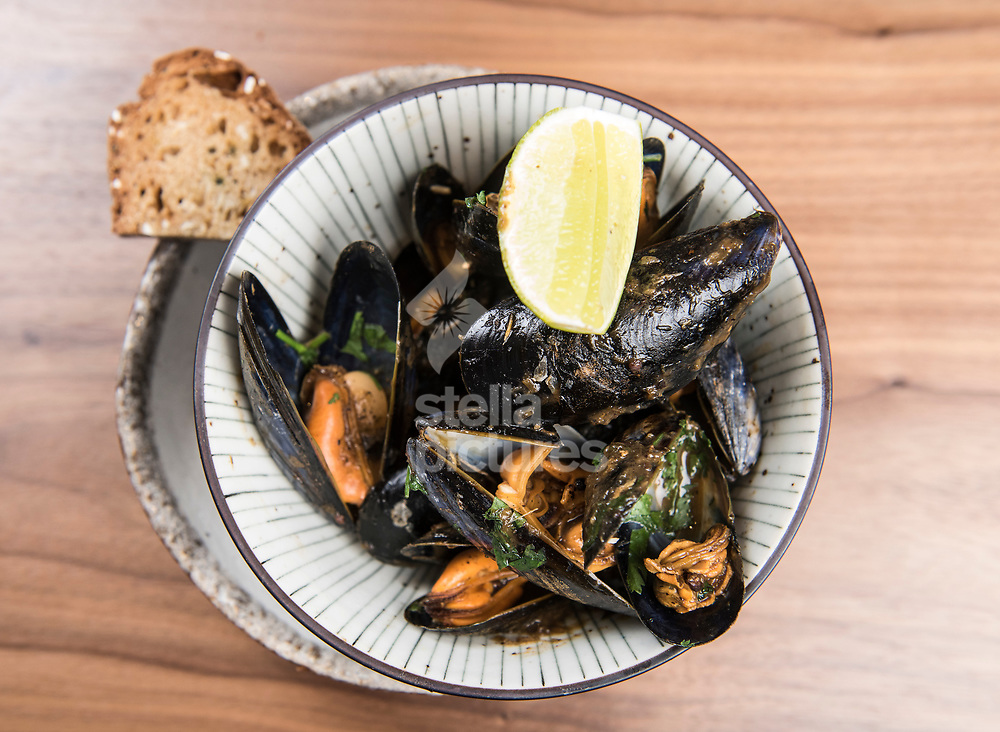 Caribbean-style mussels at Flavour Bastard in Soho as part of restaurant review.<br /> Picture by Daniel Hambury/Stella Pictures Ltd 07813022858<br /> 04/09/2017