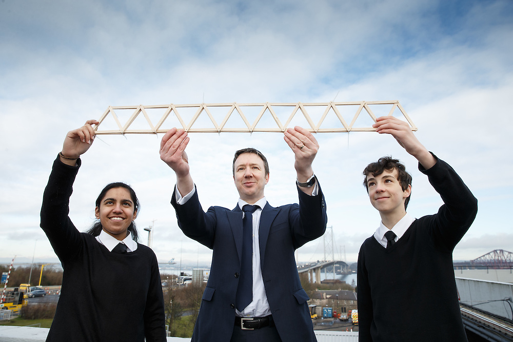 """FREE PICTURES- A new YESC project sponsored by Morrison Construction titled """"Go Forth!"""". The project is challenging science clubs across Scotland to create a suspension bridge, inspired by the Queensferry Crossing, which will then be tested at the YESC regional and national celebrations. SCDI's Young Engineers and Science Clubs (YESC) Scotland has created an exciting new engineering project inspired by the Queensferry Crossing – the Go Forth! Challenge. <br /> Over 300 schools across Scotland, from Shetland to Dumfries, are receiving free kits containing all they need to design and build a suspension or cable-stayed bridge. <br /> Pupils from Trinity Academy , Edinburgh with the beginnings of their bridge. In the background is the Queensferry and Forth Rd bridges. L to R: Shumaila Anwar, David Wilson, Director, Morrison Construction and Sean Mclean.<br /> <br /> <br />  Picture Robert Perry 26th Feb 2016<br /> <br /> Please credit photo to Robert Perry<br /> <br /> Image is free to use in connection with the promotion of the above company or organisation. 'Permissions for ALL other uses need to be sought and payment make be required.<br /> <br /> <br /> Note to Editors:  This image is free to be used editorially in the promotion of the above company or organisation.  Without prejudice ALL other licences without prior consent will be deemed a breach of copyright under the 1988. Copyright Design and Patents Act  and will be subject to payment or legal action, where appropriate.<br /> www.robertperry.co.uk<br /> NB -This image is not to be distributed without the prior consent of the copyright holder.<br /> in using this image you agree to abide by terms and conditions as stated in this caption.<br /> All monies payable to Robert Perry<br /> <br /> (PLEASE DO NOT REMOVE THIS CAPTION)<br /> This image is intended for Editorial use (e.g. news). Any commercial or promotional use requires additional clearance. <br /> Copyright 2016 All rights protected.<br /> first use onl"""