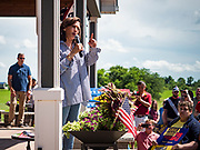 """04 JULY 2019 - INDIANOLA, IOWA: US Senator KAMALA HARRIS (D-CA) speaks to a crowd of about 200 people in Indianola Thursday afternoon. Sen. Harris attended a """"house party"""" in Indianola as a part of her campaign to be the Democratic nominee for the US presidency in 2020. Iowa traditionally holds the first selection of the presidential election cycle. The Iowa caucuses are Feb. 3, 2020.       PHOTO BY JACK KURTZ"""