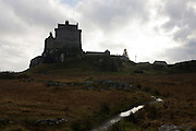 Duart Castle near Craignure, Isle of Mull, Scotland. Standing proudly on a clifftop guarding the Sound of Mull, Duart enjoys one of the most spectacular and unique positions on the West Coast of Scotland. For over 400 years this has been the base of the Scots Clan Maclean's sea-borne power. Duart was originally a rectangular wall enclosing a courtyard. In 1350 Lachlan Lubanach, the 5th Chief, married Mary Macdonald, the daughter of the Lord of the Isles and she was given Duart as her dowry. In 1691 the Macleans surrendered Duart and all their lands on Mull to the Duke of Argyll. The Castle, although in a fairly ruinous condition was used as a garrison for Government troops until 1751. It was then abandoned until 1910 when it was purchased by Sir Fitzroy Maclean, 26th Chief. (http://www.duartcastle.com/castle/castle_briefhistory.html).