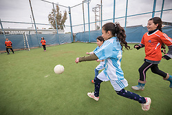 20 February 2020, Za'atari Camp, Jordan: Girls chase the ball during football practice for girls in the Peace Oasis, a Lutheran World Federation space in the Za'atari Camp where Syrian refugees are offered a variety of activities on psychosocial support, including counselling, life skills trainings and other activities.