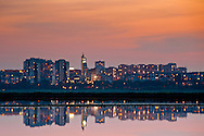 A city reflections in the lake at dusk