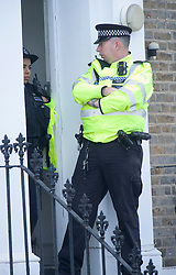 © Licensed to London News Pictures 22/10/2021.<br /> Woolwich, UK, Police at a house near the scene. A murder investigation has been launch by police after a man was found collapsed in Woolwich, South East London on Thursday 21st. The man was pronounced dead at the scene a large crime scene is in place which is causing traffic problems in the area. Photo credit:Grant Falvey/LNP
