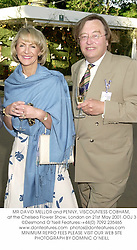 MR DAVID MELLOR and PENNY, VISCOUNTESS COBHAM, at the Chelsea Flower Show, London on 21st May 2001.	OOJ 3