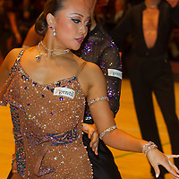 Motomitsu Shimizu and Miyuki Maruichi from Japan perform their dance during the Professional Rising Stars Latin-american competition of the International Championships held in Brentwood International Centre, Brentwood, United Kingdom on October 19, 2010. ATTILA VOLGYI