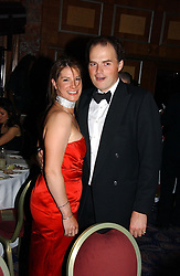The HON.SELINA TOLLEMACHE and MR EVY HAMBRO at the Boodles Boxing Ball in aid of the sports charity Sparks  organised by Jez lawson, James Amos and Charlie Gilkes held at The Royal Lancaster Hotel, Lancaster Terrae London W2 on 3rd June 2006.<br /> <br /> NON EXCLUSIVE - WORLD RIGHTS