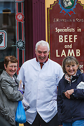 Butcher and customers, Westport, County Mayo, Ireland
