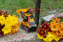 © Licensed to London News Pictures 07/03/2021. Greenwich, UK. A toy truck at the scene. Police and London Fire Brigade forensic teams continue to work at the scene of a fatal fire that killed a five year old boy and has left the rest of his family in hospital. The property in Greenwich, South East London is still cordoned off today with flowers and balloons being placed at the scene. Photo credit:Grant Falvey/LNP