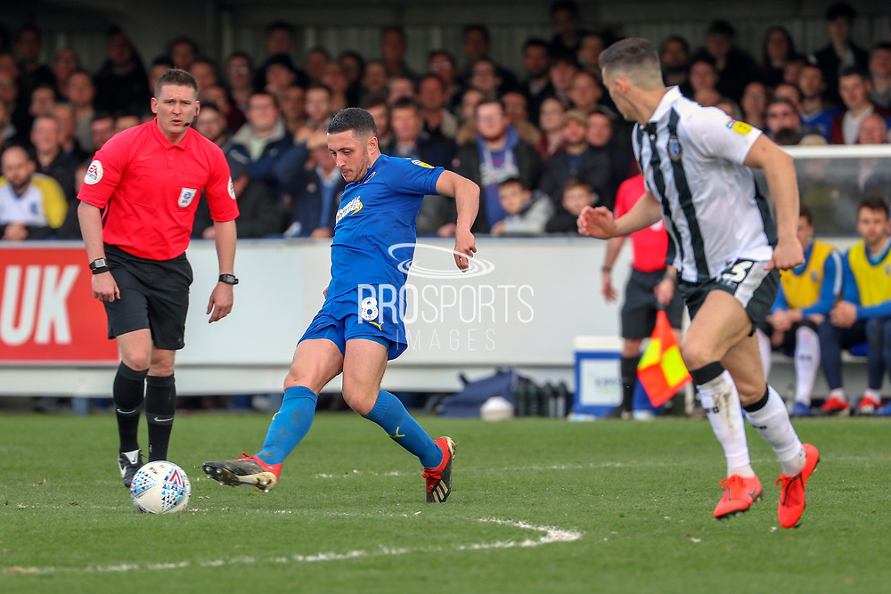AFC Wimbledon midfielder Anthony Hartigan (8) passing the ball during the EFL Sky Bet League 1 match between AFC Wimbledon and Gillingham at the Cherry Red Records Stadium, Kingston, England on 23 March 2019.