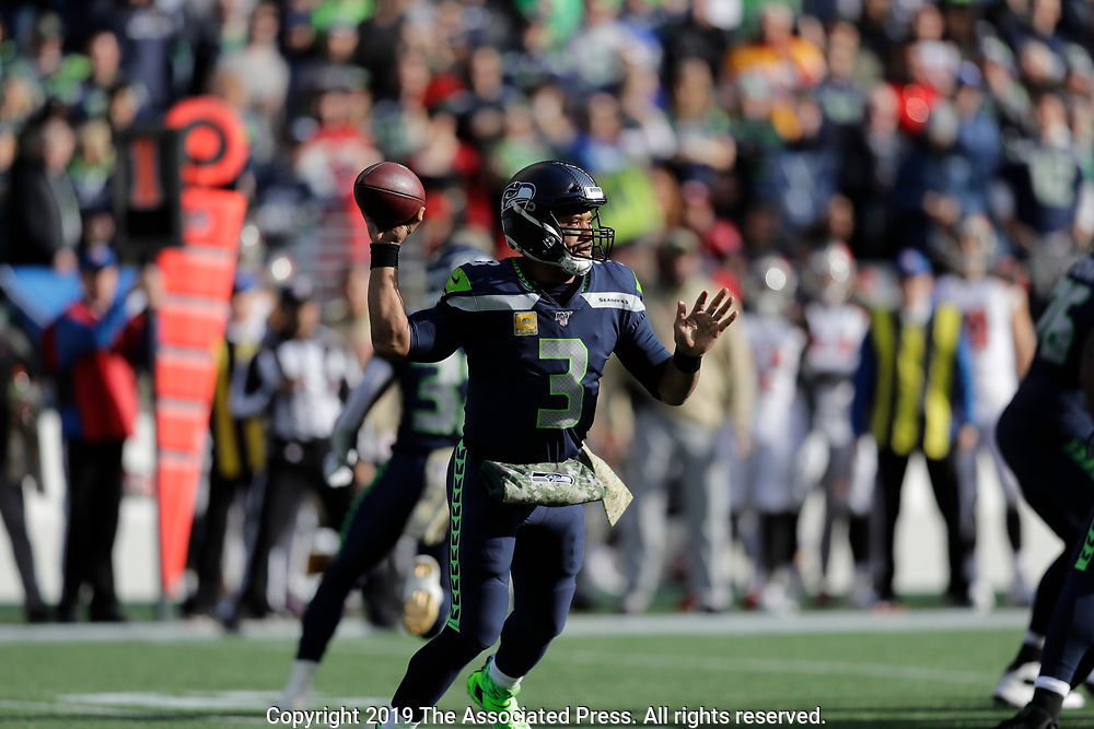 Seattle Seahawks quarterback Russell Wilson passes against the Tampa Bay Buccaneers during the first half of an NFL football game, Sunday, Nov. 3, 2019, in Seattle. (AP Photo/John Froschauer)