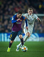 Lionel Messi of FC Barcelona competes for the ball with Kroos (right) of Real Madrid,during the first match of the Spanish King's Cup semifinal at Camp Nou Stadium in Barcelona,Spain,6 February 2019
