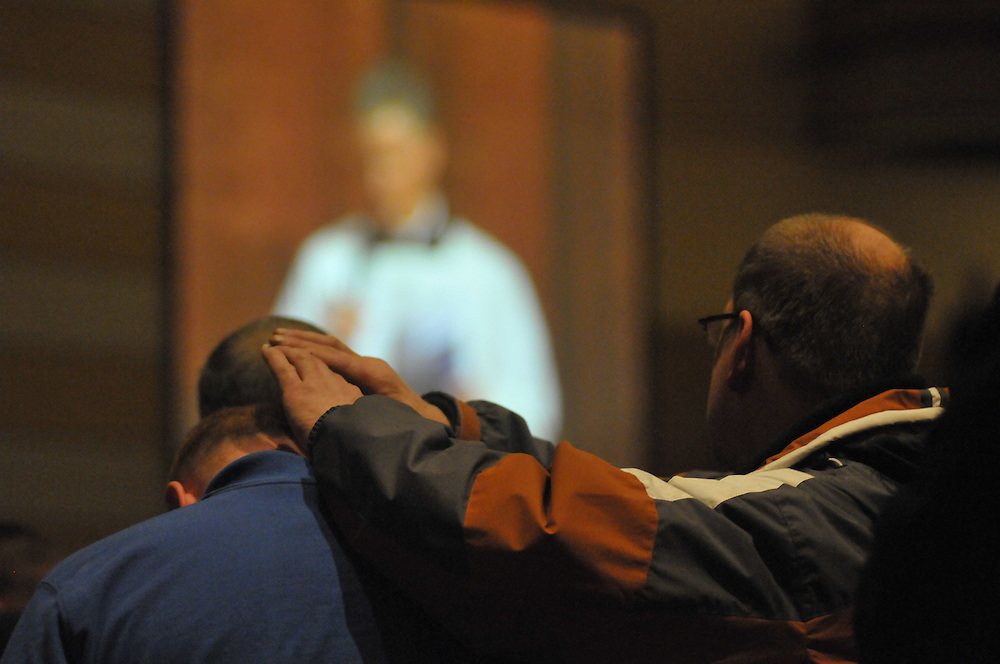 Fathers are asked to hold their hands over their son's head during the father son blessing.